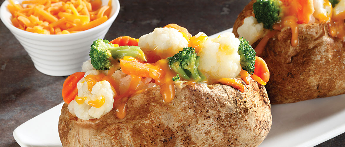 baked potato with cheesy vegetable topping