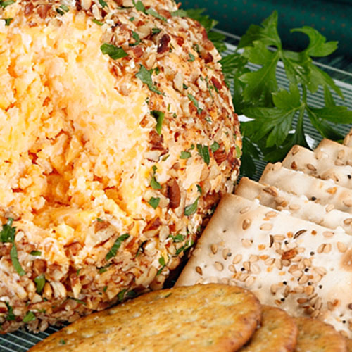 cheese ball with crackers and garnish on the side
