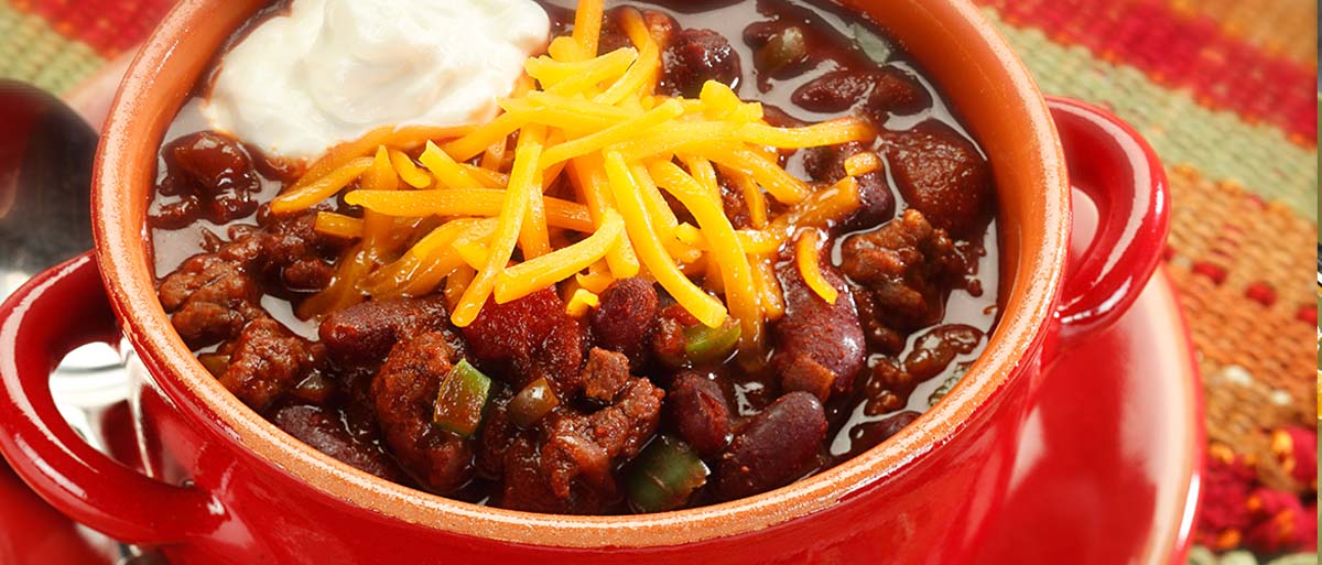 slow cooker chili in a red bowl