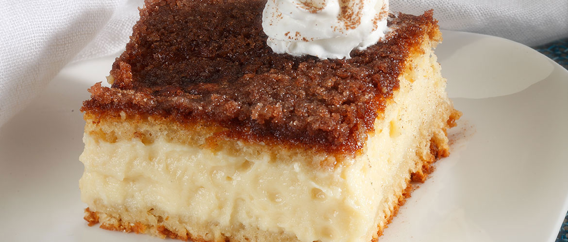 sopapilla cheesecake slice with dollop of whipped cream on top