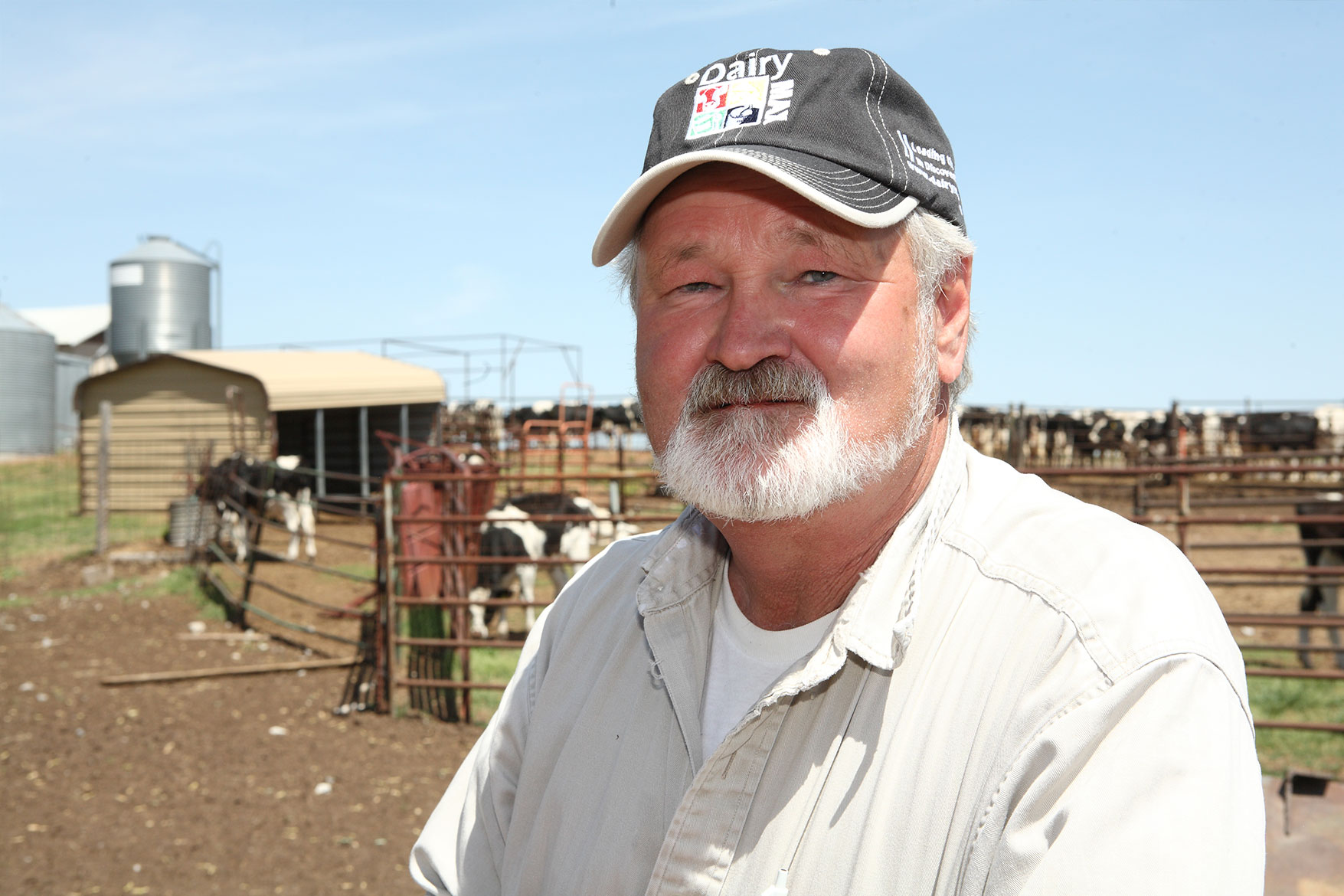 Donny Chapman poses for a photo in front of his dairy farm.