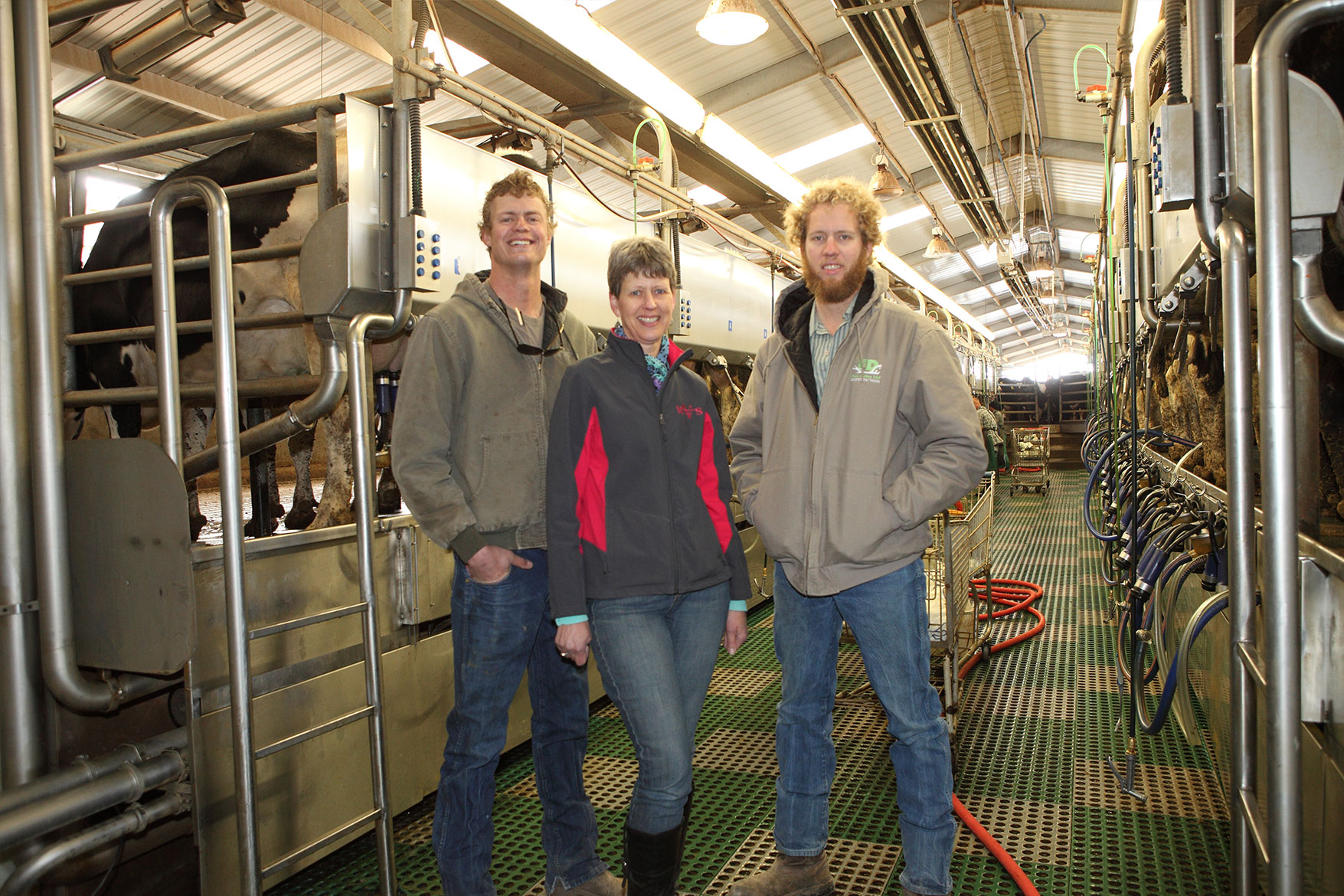 The DeVos family inside the milking parlor at Fox Dairy.