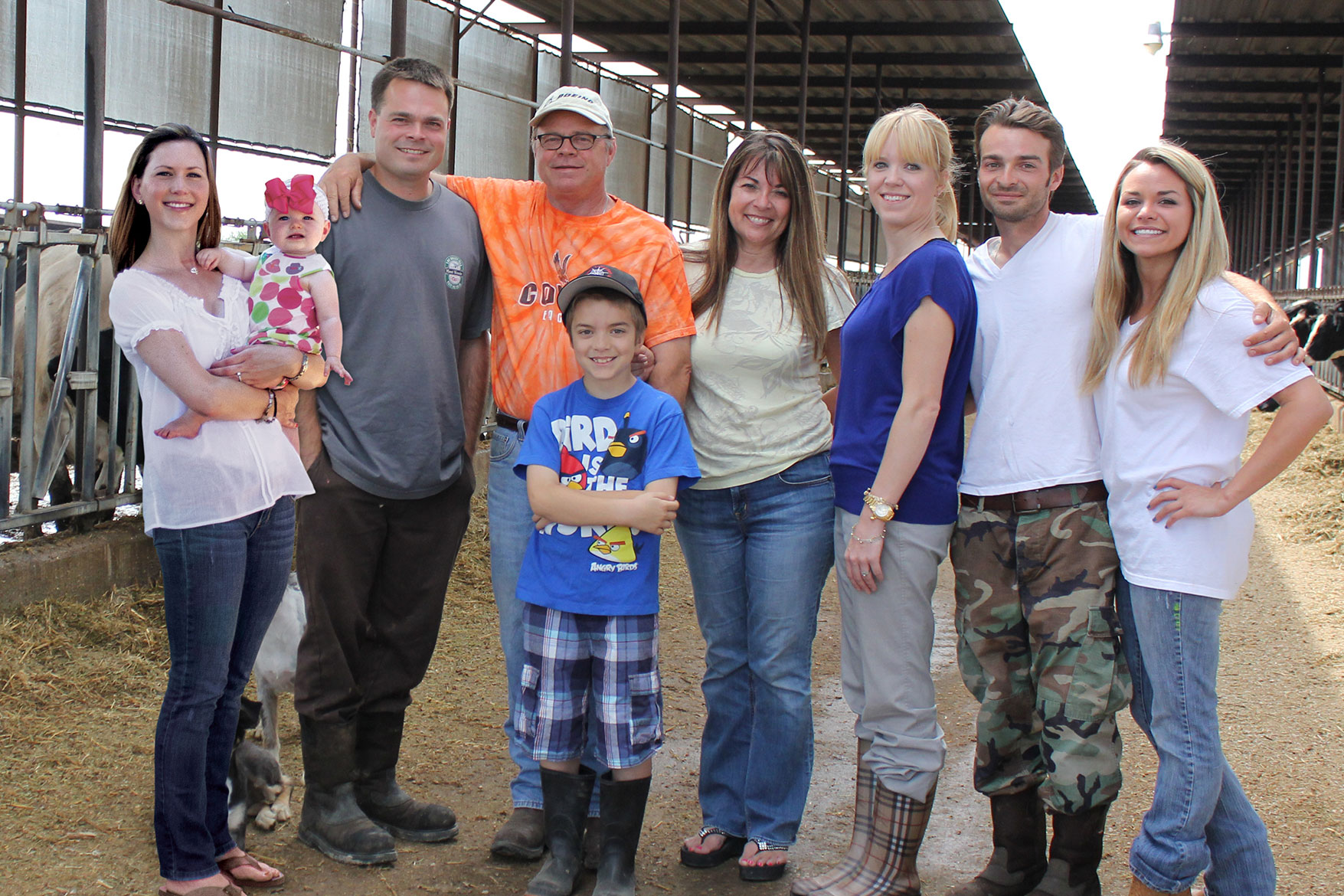 The Strona family poses for a picture in their barn.