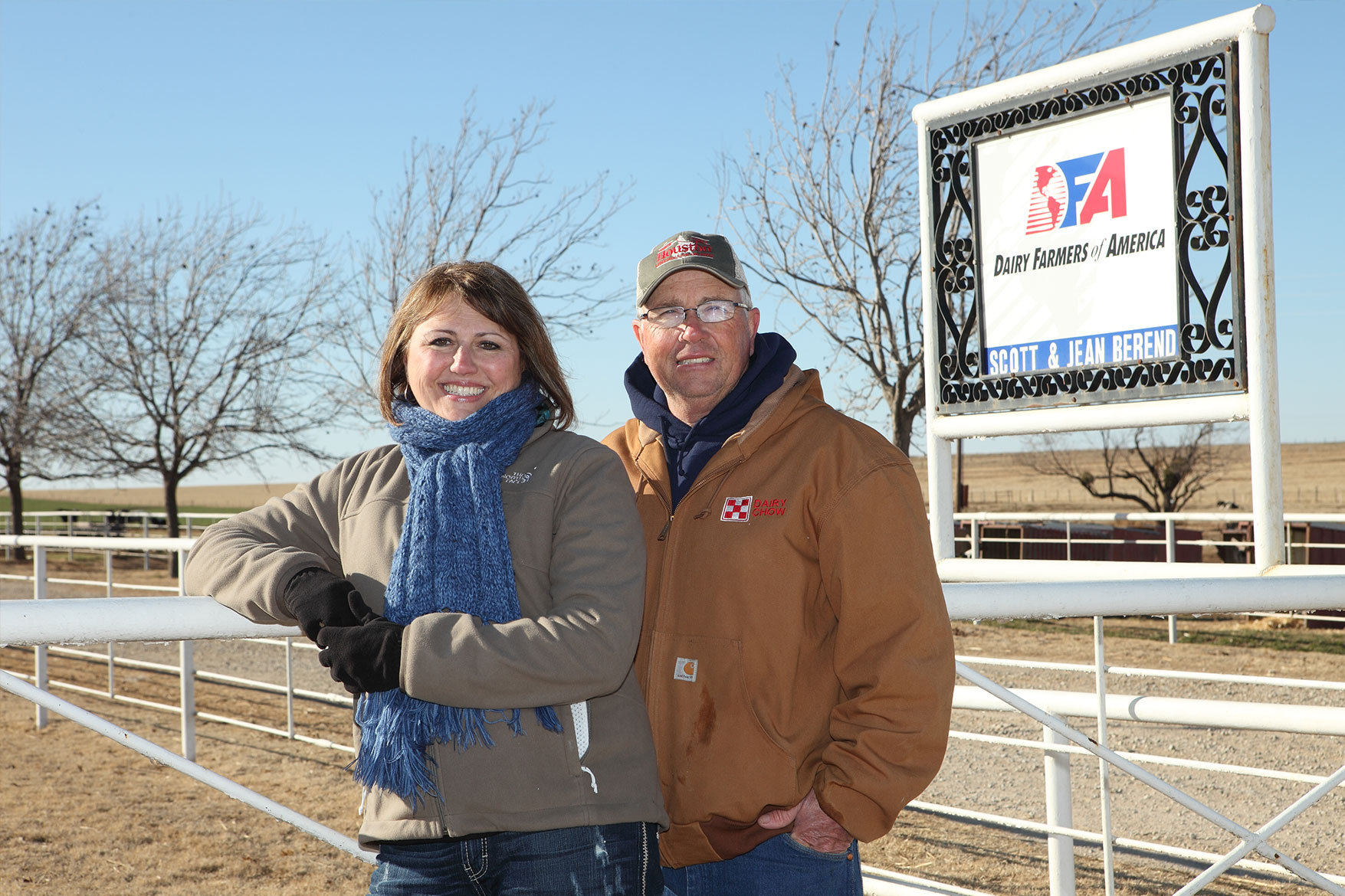 Scott and Jean Berend pose for a photo in front of their dairy sign.