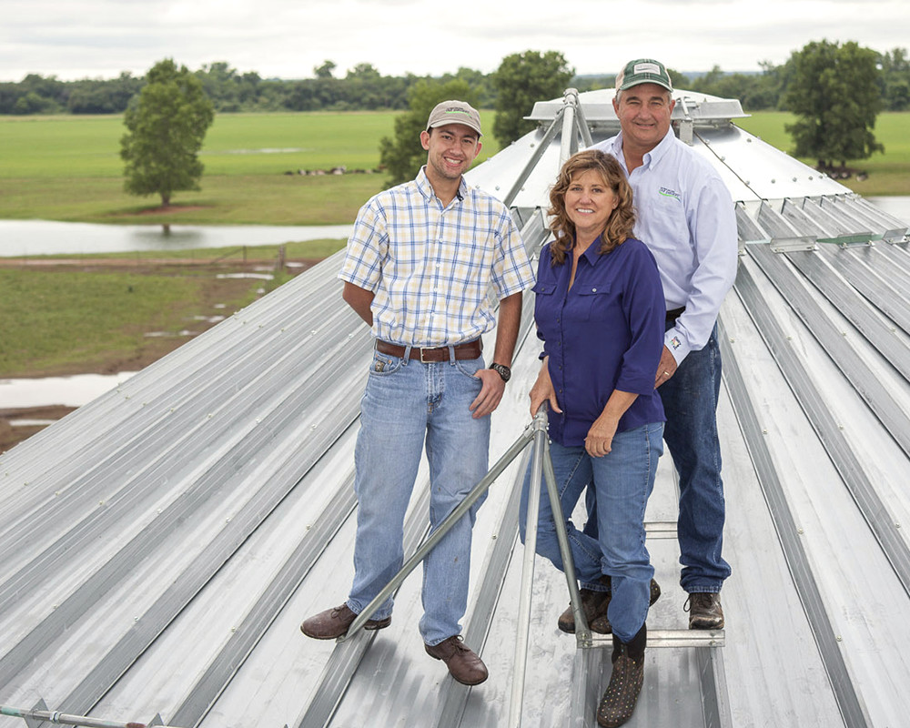 The Jackson family poses on top of their silo.