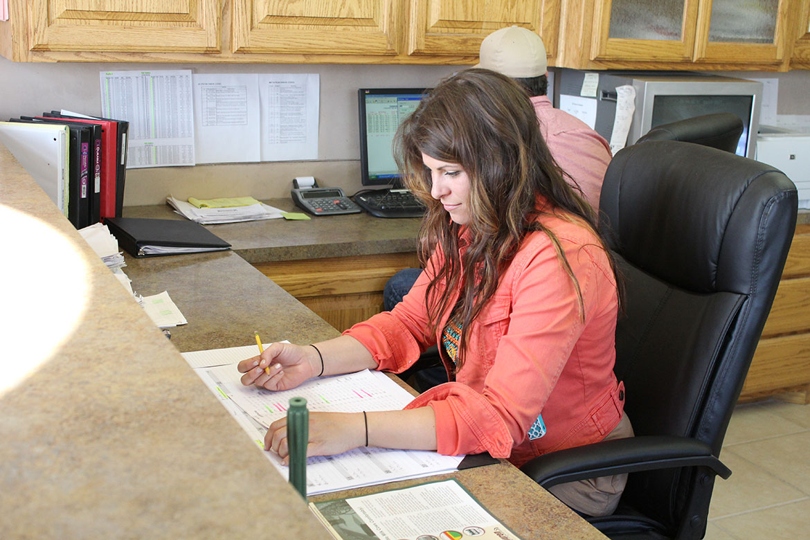 Crystal Gingg works at the front office of Del Rio Dairy.