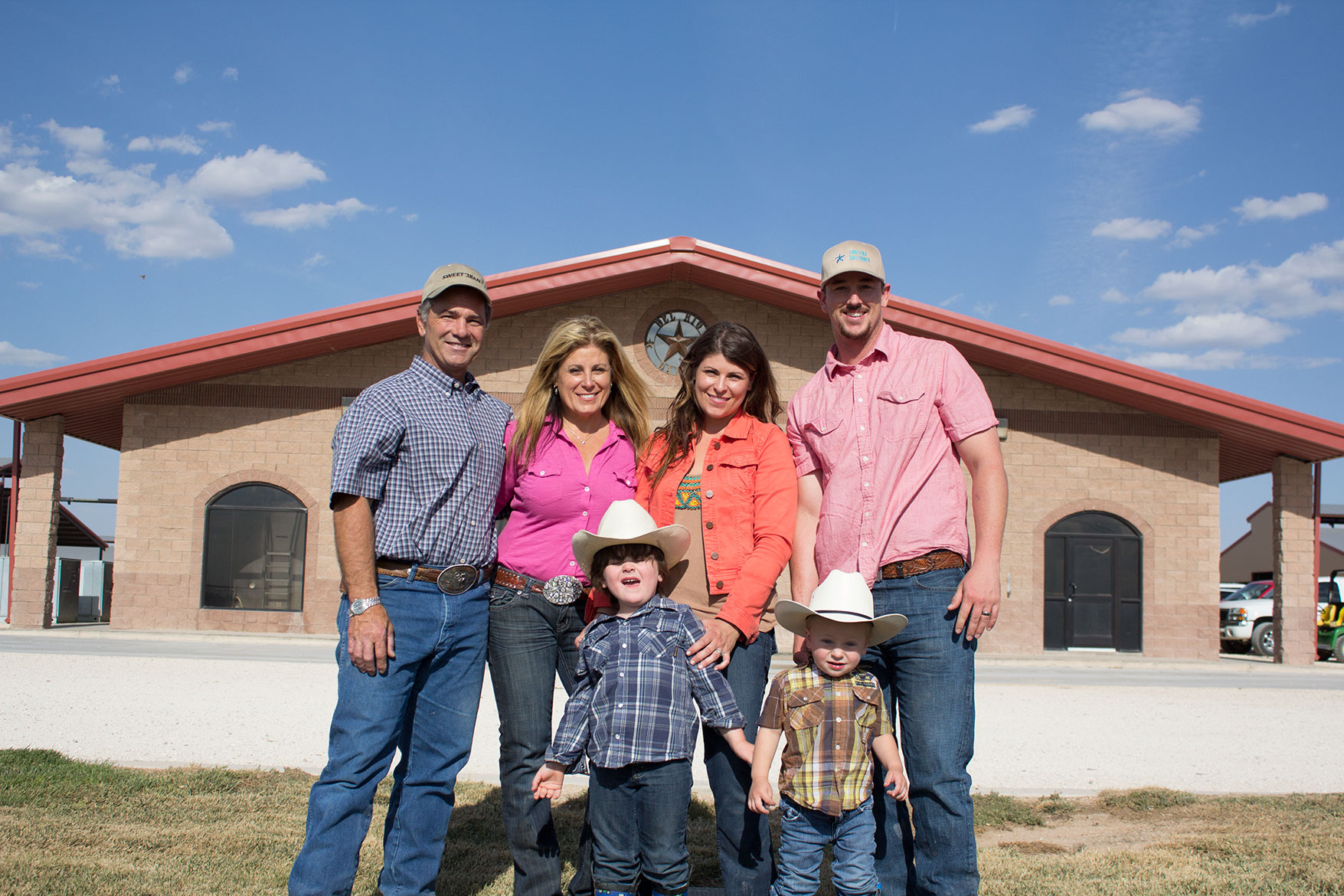 The Gingg family poses for a photo in front of the milking parlor.