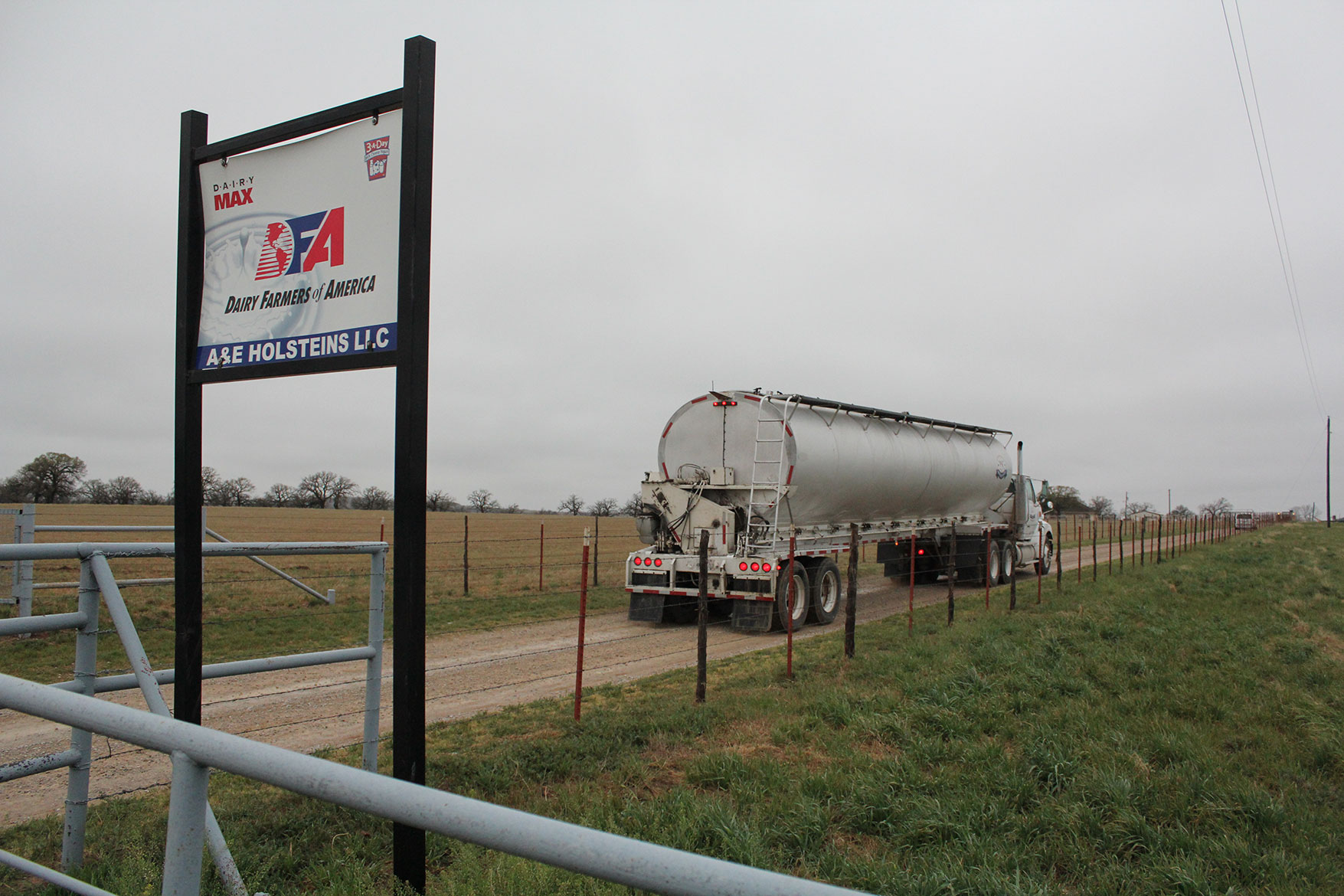 The feed truck delivers feed ingredients to the dairy farm.