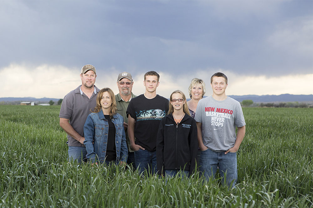 The Jones family takes a photo in one of their fields.