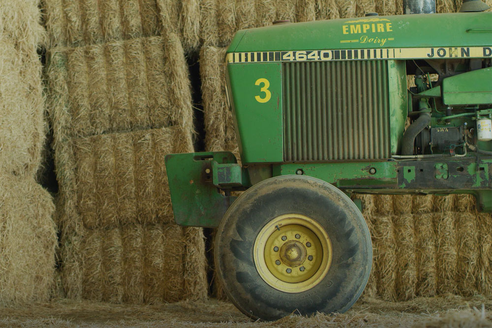 A custom-painted tractor has the Empire Dairy logo.