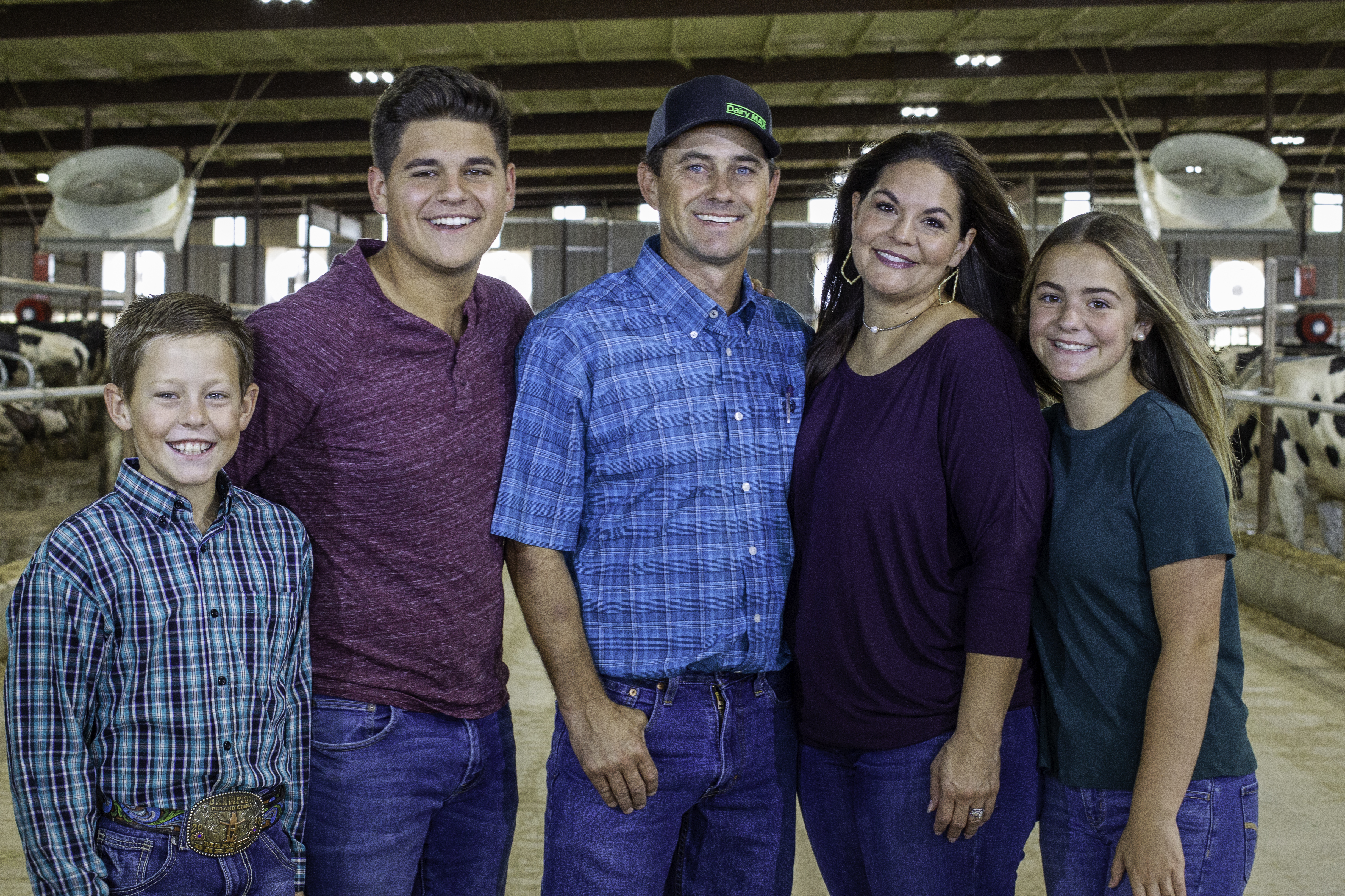 The Collier family poses for a photo in their barn.