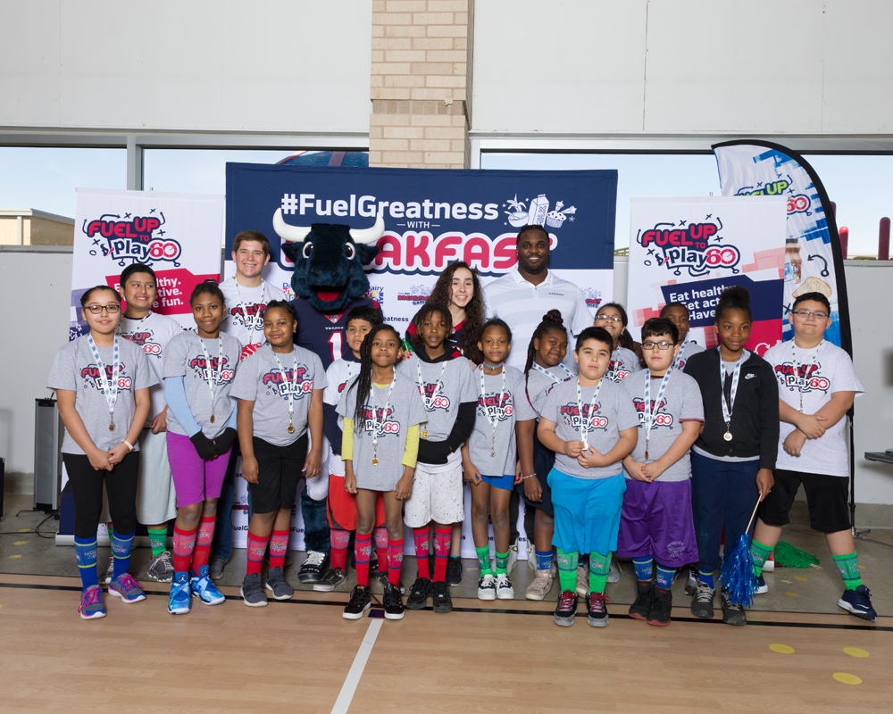 DJ Reader, Toro and a group of Fuel Up to Play 60 students