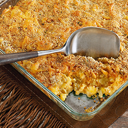 child corn casserole with a serving spoon