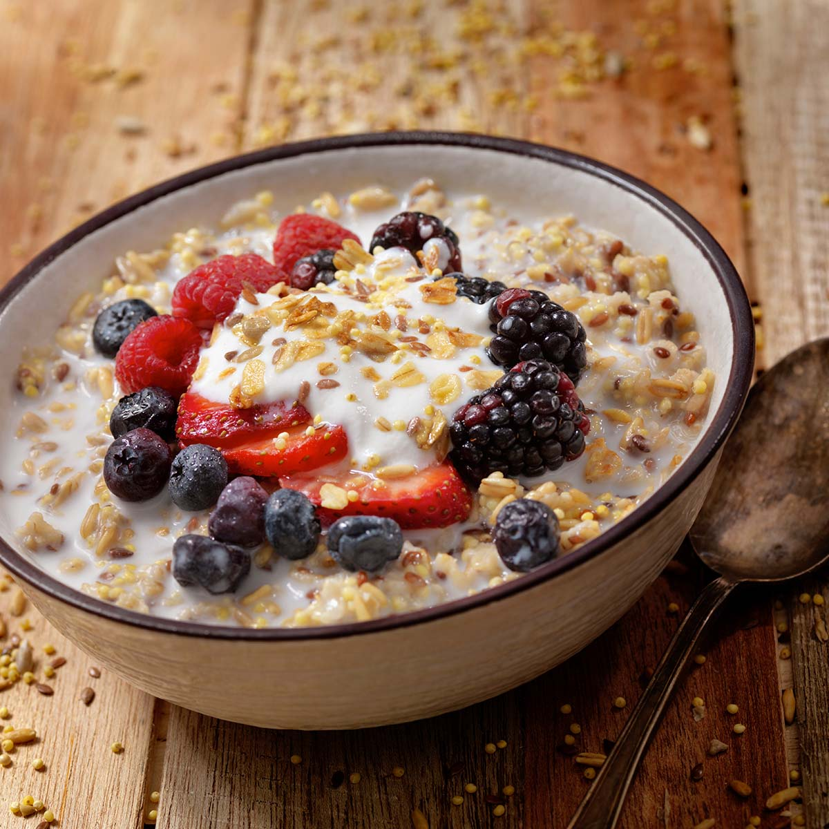 bowl of oatmeal with fruit on top