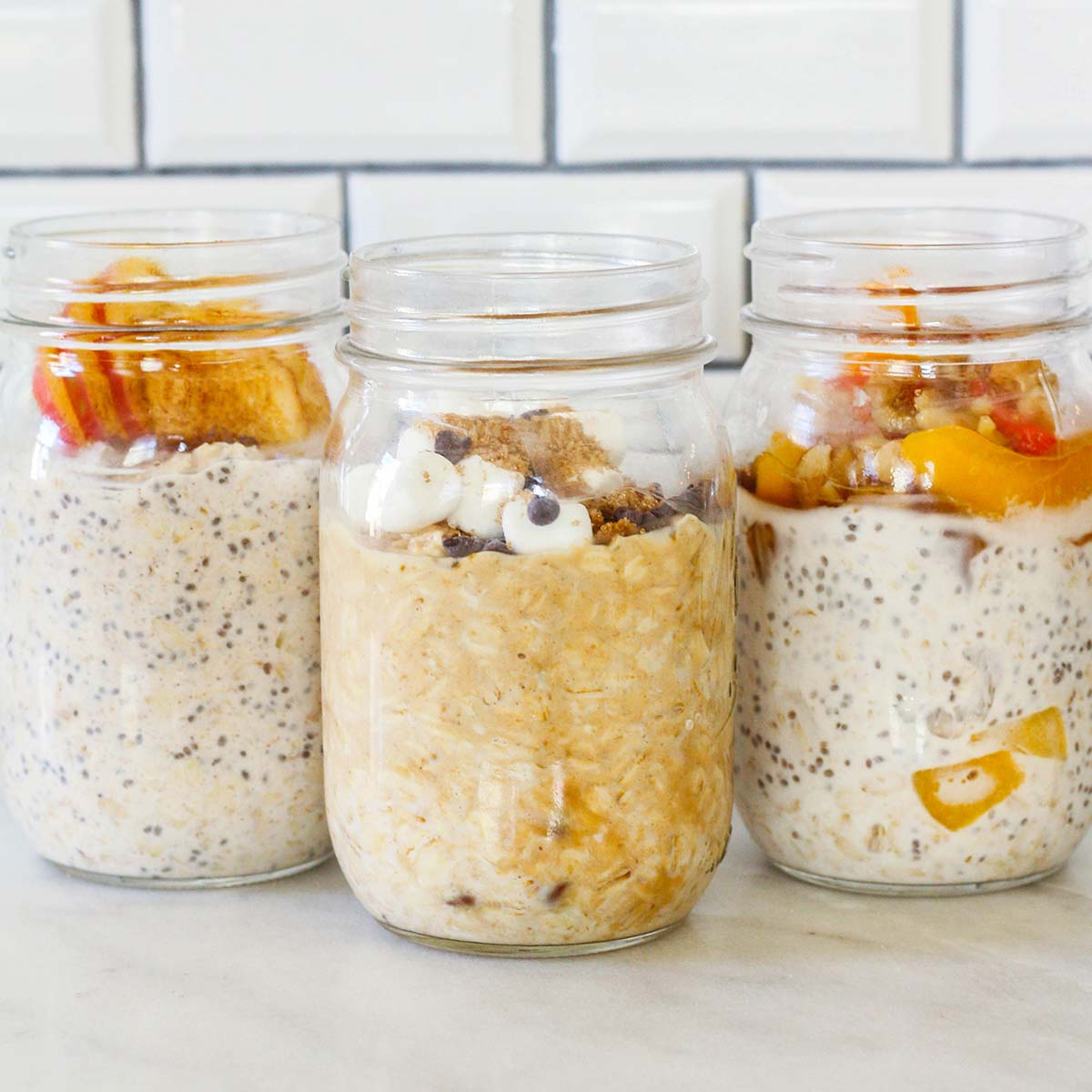 three jars with overnight oats in each and different toppings