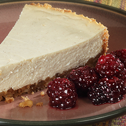 greek yogurt cheesecake with blackberries on the side