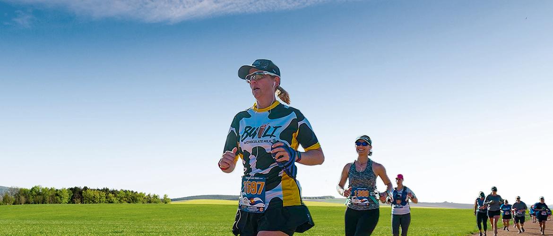woman running in Holstein print running shirt