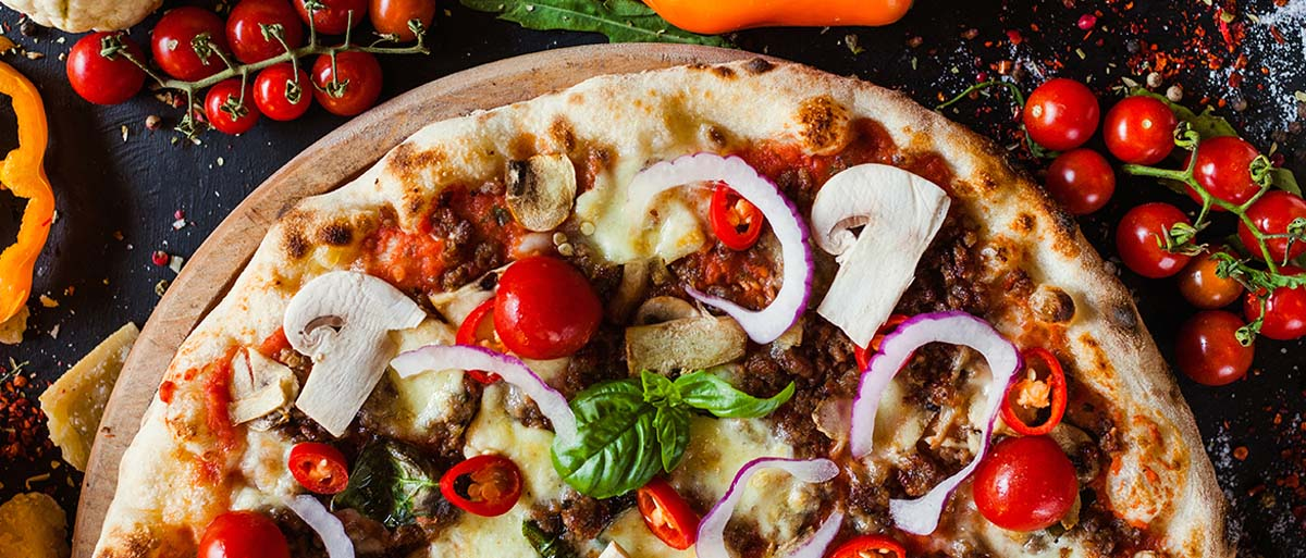 pizza with mushrooms, onions and tomatoes
