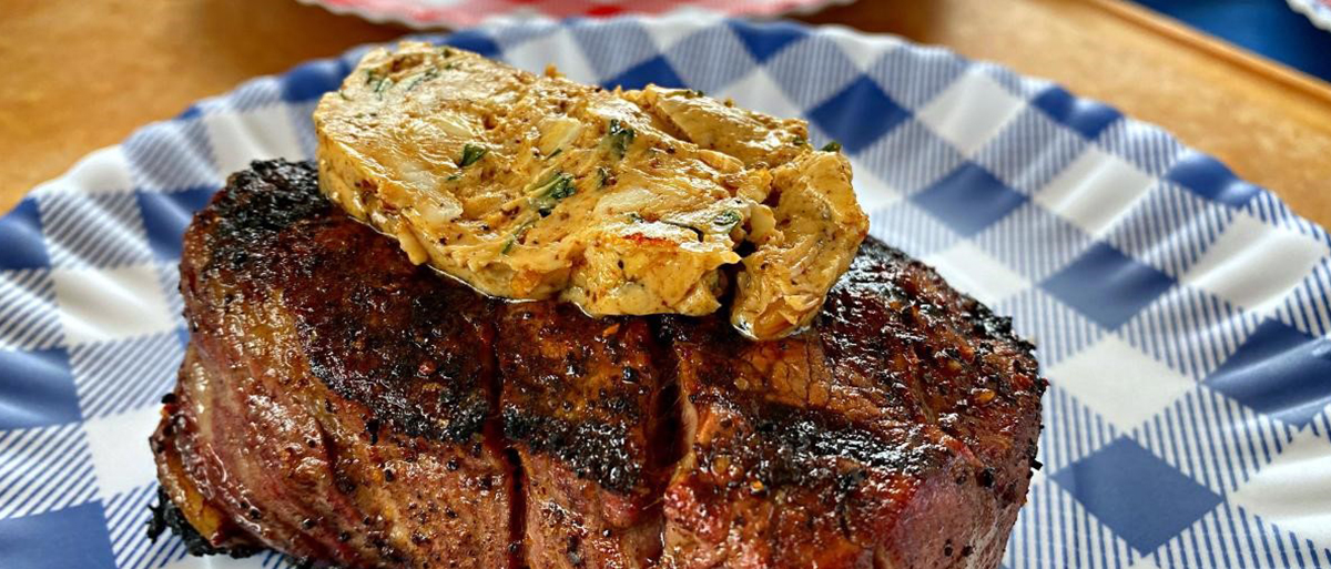 photo of a steak with butter on top