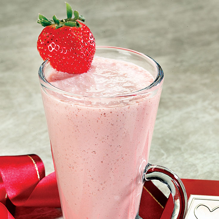 pink smoothie with a strawberry garnish