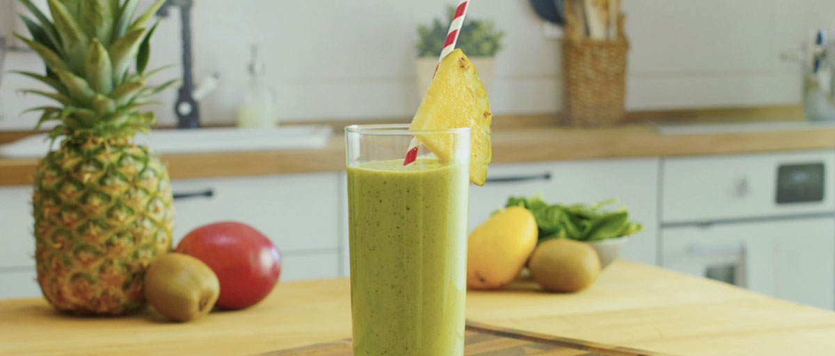 go green smoothie garnished with pineapple