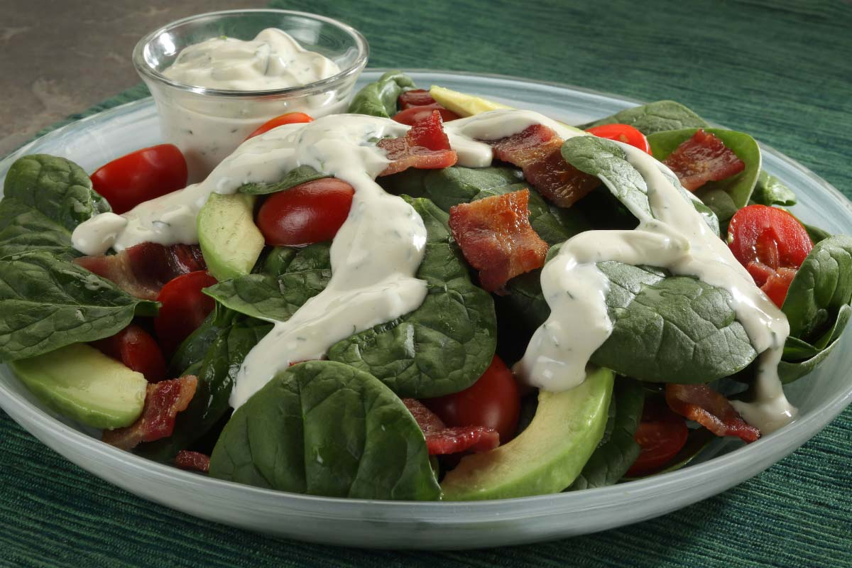 greek yogurt dressing on a salad