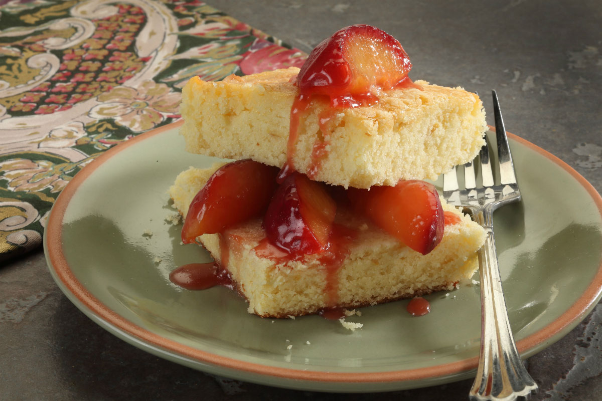 pound cake on a plate with strawberry topping