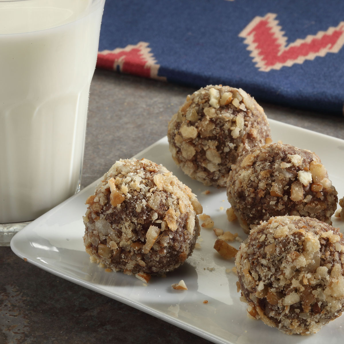 Pecan Pie Truffles with a glass of milk on the side