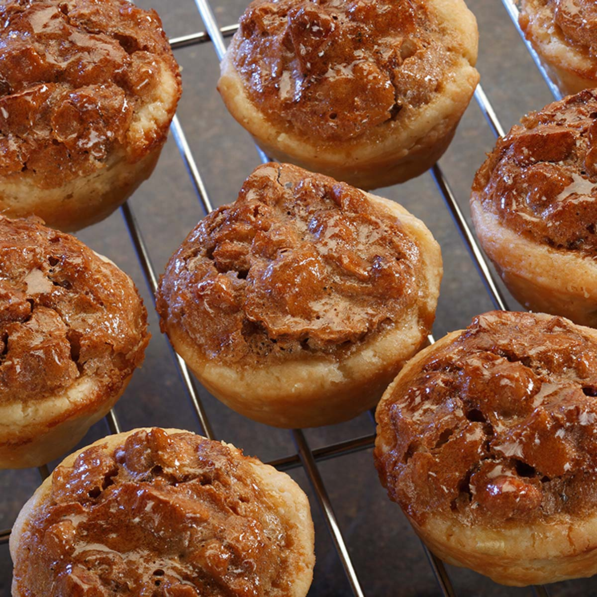 pecan tarts on a cooling rack