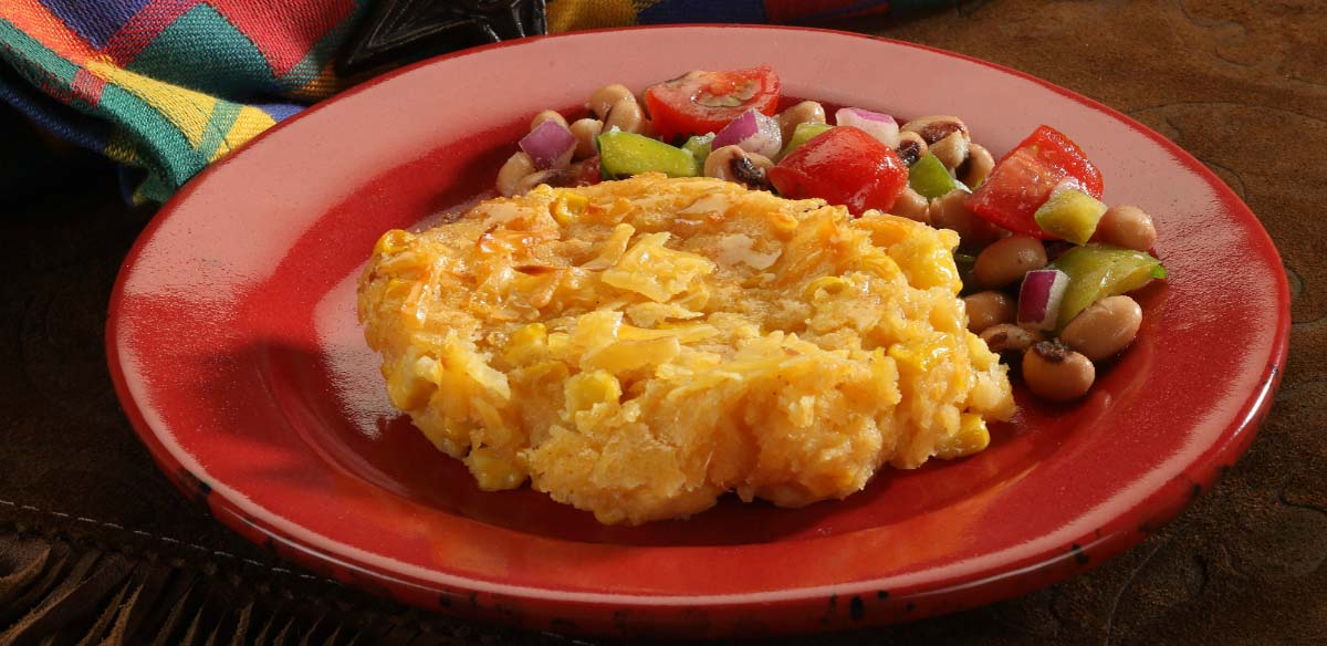 smoked gouda spoon bread on a red plate