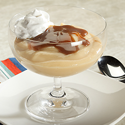butterscotch pudding in a glass dessert bowl