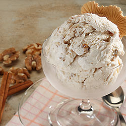 cinnamon walnut ice cream in a glass serving bowl