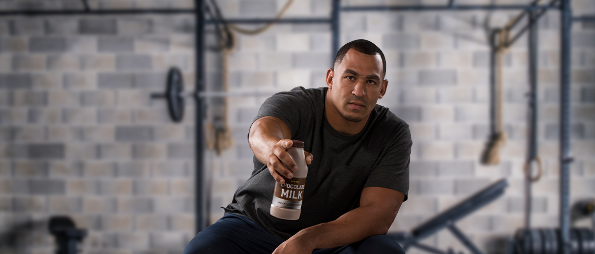 tyrone crawford holding out a bottle of chocolate milk